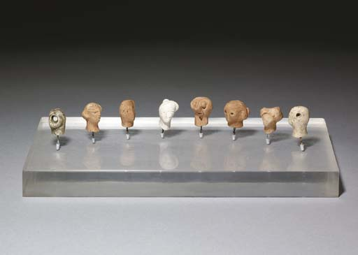 Eight plaster heads, Illustration by Henry Moore (1898-1986, United Kingdom)