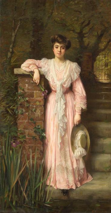 A portrait of a lady in a garden wearing a pink dress holding an iris by Thomas Benjamin Kennington (1856-1916, United Kingdom) | Museum Quality Reproductions | ArtsDot.com