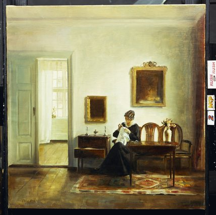 A Woman Sewing In An Interior by Carl Vilhelm Holsoe (1863-1935, Denmark)