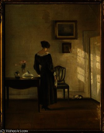 An Interior with a Woman feeding a Cat by Carl Vilhelm Holsoe (1863-1935, Denmark)