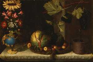 Bernardo Polo - Still life of a sunflower and other blooms in a gilt mounted bluestone vase, together with melons, apricots, grapes and plums in a pewter dish alongside a planter with grapes on a vine branch, all on a carved marble ledge